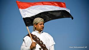 Image result for A supporter of Houthi Shiites holds a Yemeni flag PHOTO