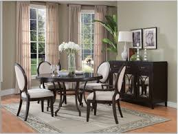 elegant square black mahogany dining table: minimalist round black dining room table design idea with white chairs gray rug and flowers