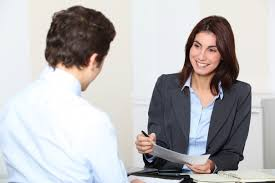 Tips for Working With a Recruiter or Headhunter As an Individual ... woman interviewing man for a job