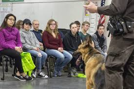 from police dogs to firefighter gear teens get up close view of deputy jamie ottinger from muskegon county sheriff s office demonstrates police work his canine deputy rex during criminal justice career day for teens