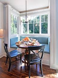 bay windows with built in sofa in blue color round wood table with a pair of bay window furniture