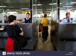 customs officer airport stock photos customs officer airport passport control at schiphol airport stock image