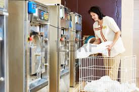 woman loading laundry washing machine with stock photo picture and royalty free image image 41478130 laundry presser