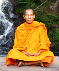 meditation buddhist monk meditating in a waterfall setting