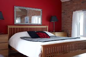 bedroom design red contemporary wood: simple bedroom with elevated bed brick wall and red wall