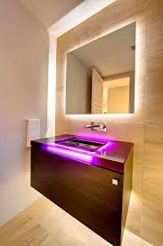 f amazing lighting interior decors of bathroom vanity with purple electric led lighted on sink cabinet and bright recessed vanity light behind wall mirror amazing amazing bathroom lighting ideas picture