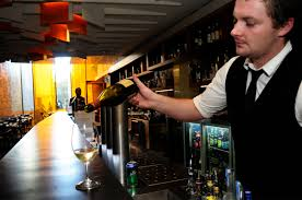 where to wet your whistle during the g the source news bar manager matthew fearnley 25 pours a glass of wine at the laneway