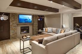 the seating area wraps the large leather sectional holding silver and gold throw pillows amazing ceiling lighting ideas family