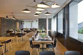 emily group of three pendant lamps in swiss restaurant by daniel becker design studio berlin becker lighting