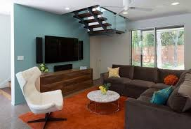 wall paint with brown furniture. blue wall paint and living room furniture in dark brown color with t