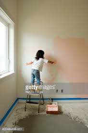 painting bedroom girl painting bedroom wall rear view stock photo getty images