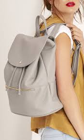 Grey <b>perforated backpack</b> made from buttery soft vegan leather ...