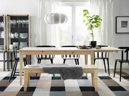 ikea dining room chairs rectangle black wood dining table tall candles light holders white brown sofa set laminate wood floor silk flower centerpiece black wood dining room