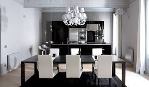 black and white dining table set: black and white dining room with white dining room chairs and classic white chandelier above black