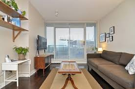 the living room with access to a small balcony balcony furnished small