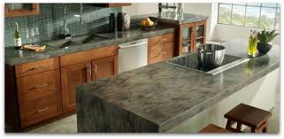 corian kitchen top: corian countertops color sorrel on kitchen island glass tile backsplash