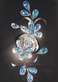beautiful blue aurora borealis crystals adorn this rather special italian wall light its 42 centimetres beautiful lighting uk