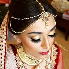 red and gold bridal makeup lashes shadow red lips red lipstick matha patti indian bride indian