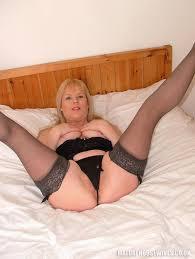 Mature Shaved Blonde MILF Alex UK with Big Tits Wearing Black.