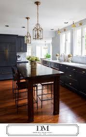 modern kitchen cabinet hardware traditional: charcoal gray kitchen wood island brass fixtures hardware via design manifest dark gray