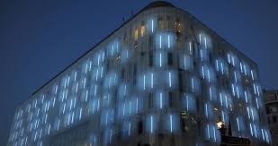 a building facade uses lights to paint central london codesign business design building facade lighting
