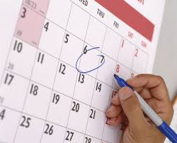 what to do when you ve lied on your resume w s hand marking a date on a calendar close up