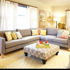 light and bright living room neutral furniture pops of color bold print on bold living room furniture
