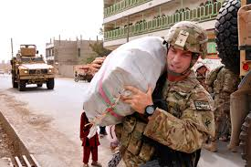 u s department of defense photo essay u s army 1st lt michael inscho carries a sack of rice to a farah orphanage