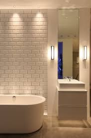 wall lights create atmosphere and help light the mirrors bathroom lighting rules