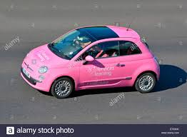 pink fiat car advertising for cleaning services stock photo pink fiat car advertising for cleaning services