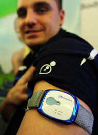 Nick Wilson displays the BodyMedia Fit Core Armband which measures motion, heat flux, skin temperature and galvanic skin response to track calorie burn, ... - bodyMediaFitCoreAr_2105278i