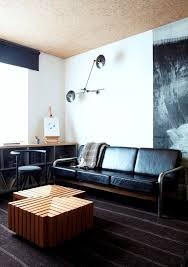 mid century modern black leather sofa in a contemporary home with interesting accents black leather mid century