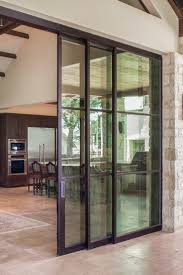 large sliding patio doors: large sliding steel doors obscure the boundary brining the outdoors inside and allowing guests to flow freely from interior living space to