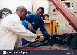 trainee car mechanic learning mechanical skills stock photo stock photo trainee car mechanic learning mechanical skills