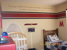 room decor painting boys partition with crib and bed in the aviation themed boy  s room