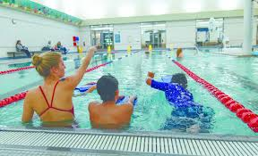 waterplay safety tips for a season of fun com com water safety instructor julia douglas two swimmers at the troy community center in