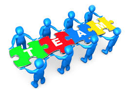 key skills to being a good lawyer tip 2 team work elevation team of 8 blue people holding up connected pieces to a colorful puzzle that spells out