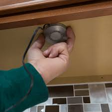 attaching the puck to the already mounted cap adding cabinet lighting