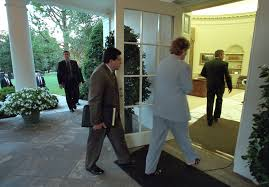 counselor karen hughes and counsel alberto gonzales follow president george w bush into the oval bush library oval office