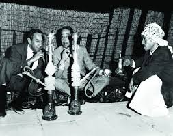 louis armstrong plays trumpet at the ian pyramids dizzy duke ellington smoking a hookah in
