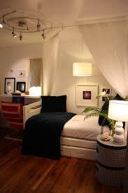 bedroom track lighting f inspiring small bedroom design with white painted oak wood single bed under bedroom lighting design ideas