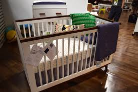 babyletto grayson mini crib with dark wood floor colors babyletto furniture