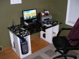 black and white cool desks on laminate wood flooring and black office chair plus peel and steak wallpaper for elegant office room design amazing black glass office