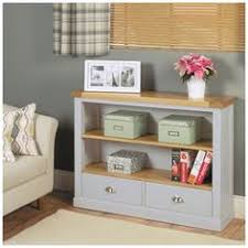 with two shelves and two drawers with extra space on the surface to display your favourite items part of our fresh and elegant grey painted chadwick chadwick satin lacquered oak hidden home
