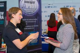 career fairs employers partners wpi female alumna talking to female student at the career fair