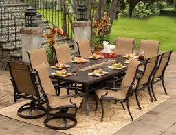f remarkable outdoor patio furniture ideas for backyard showing off rectangular wrought iron dining table with ten units dining chairs in light brown backyard furniture ideas