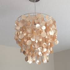 i just love how this light fixture picks up the light it really sparkles and adds so much warmth to our living room capiz lighting fixtures
