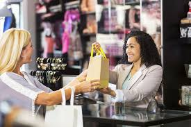 creative marketing ideas for retailers friendly s clerk customer at checkout counter