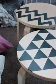 cut out black contact paper or vinyl stickers in geometric shapes can really transform the ikea frosta stool black contact paper project