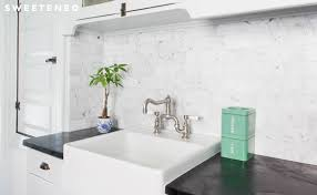 that would fit into a standard sized nyc kitchen the couple went with an up mount installation the sink lip sits above counter height that makes the apron kitchen sink kitchen sinks alcove